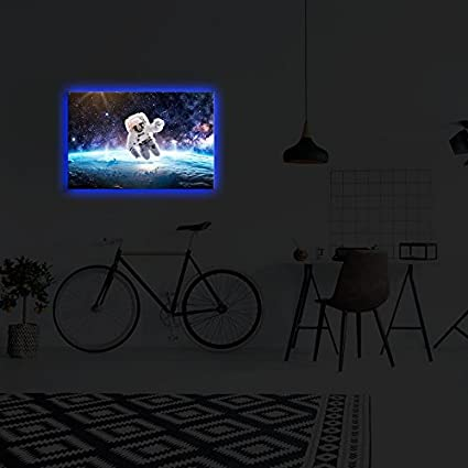Amazon com: Blue Led Lighted Canvas Wall Art - Astronaut is Floating