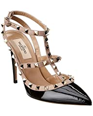 Made in Italy. Color/material: black patent leather. Design details: platinum finish rockstuds. Buckle closure. Lightly padded leather insole. Smooth leather sole. 4in heel. Please note: All measurements are approximate and were taken from a ...