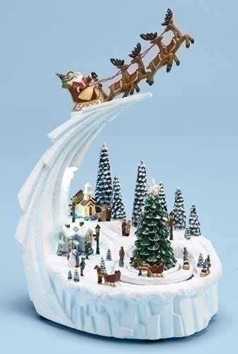 Santa Riding Over Winter Village Musical Rotating Christmas Figurine