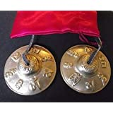 Tibetan Buddhist Hand Bells embossed with the Mantra of the Buddha of Compassion 'OM MANI PADME HUM' ;Hail to the Jewel in the Heart of the Lotus; 65cm Diameter. Comes in a Red Satin Drawnstring Carry Pouch - sold by Spiritual Gifts. Usually dispatched within 2 working days.