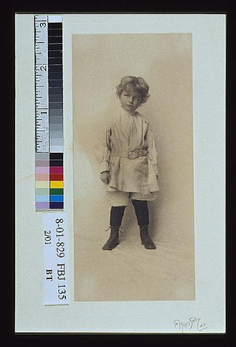 1900 Photo Portrait of a young boy standing in short pants and belted shirt] / the Misses Selby, N.Y.