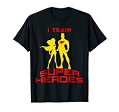 T-Shirt: I Train Super Heroes Shirt. Perfect gift present for Teachers, Comic Book Lovers, Trainers, Fitness professionals, Sports Coach, Physiotherapist, Personal trainer, ... . Gym, motivation, inspiration, workout, gym tee for men and wome...