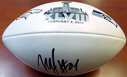 Marshawn Lynch Autographed Football - Super Bowl Xlviii Logo Ml 106231 - Autographed Footballs ()