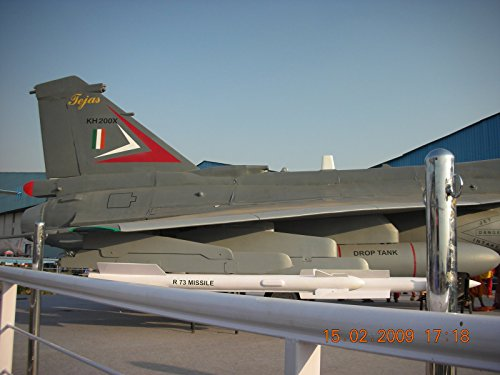 Home Comforts Laminated Poster HAL Tejas Carrying R-.73 Missile and Drop Tank at AeroIndia air Show. Vivid Imagery Poster Print 24 x - Drop Missile