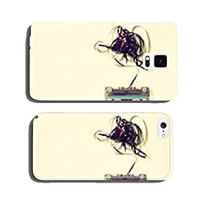 Cassette tape over wooden table with tangled ribbon. top view. r cell phone cover case iPhone5