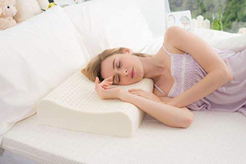 Woman sleeping with a natural latex rubber pillow supporting her head.