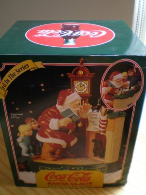 (Coca-Cola Santa Claus Mechanical Bank - Santa with Children at the Fireplace - 3rd In The Series)