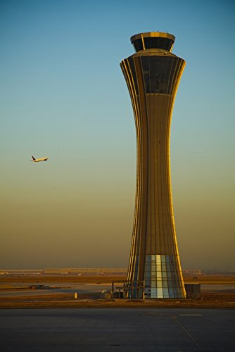 Posterazzi An Airplane Flies Past The Air Traffic Control Tower Airport Beijing China Poster Print (24 x 38)