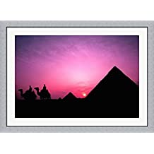 Colorful Sunset Silhouetting Men and Camels at the Great Pyramids of Giza, Egypt by Bill Bachmann / Danita Delimont Framed Art Print Wall Picture, Flat Silver Frame, 45 x 33 inches