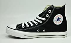 Converse The Chuck Taylor All Star Hi Sneaker in Black. Patterned high top sneaker; tonal stitching; contrast laces through metal eyelets; contrast rubber toe and sole with pinstripe. By Converse.