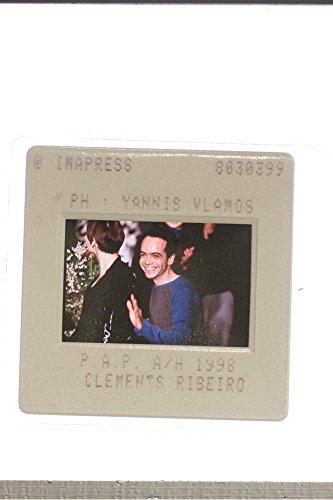 slides-photo-of-inacio-ribeiro-waving-his-hand-beside-his-wife-suzanne-clements