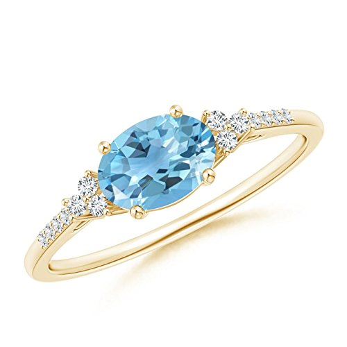 Yellowgold Horizontally Set Oval Swiss bluee Topaz Solitaire Ring with Trio Diamond Accents (7x5mm Swiss bluee Topaz)