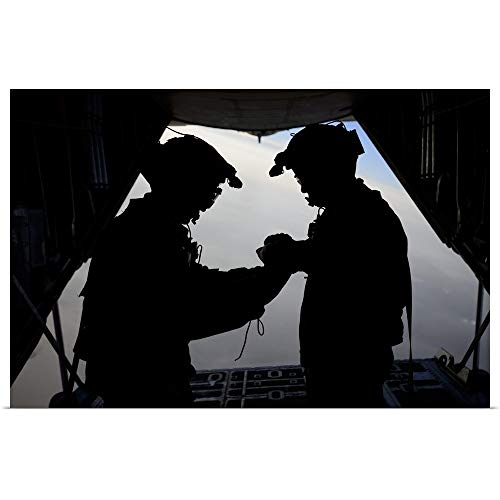 GREATBIGCANVAS Poster Print Entitled U.S. Air Force loadmasters fold The American Flag Aboard an HC-130 Hercules by Stocktrek Images 18