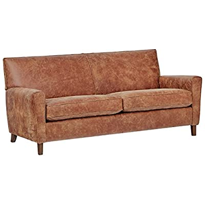"Amazon Brand – Rivet Lawson Modern Angled Leather Sofa, 78""W, Saddle Brown - You'll enjoy snuggling with family and friends, or by yourself, on this sophisticated sofa.  A sleek back, angled arms, removable seat cushions and tapered legs give it urbane, mid-century influenced style. Available in leather and fabric upholstery. This item is made to order just for you 78""W x 34""D x 34""H - sofas-couches, living-room-furniture, living-room - 41veE2JpO8L. SS400  -"
