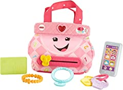 """Learning fun never goes out of style! This adorable purse helpsyour babylearn about numbers, colors, opposites and more, while offering up fun early role play! With the Laugh & Learn My Smart Purse, little ones can carry the five """"must-..."""
