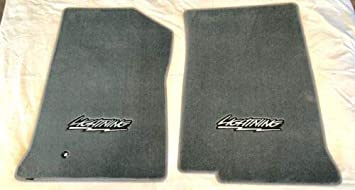 Amazon Com Lightning F150 Lloyd Velourtex Custom Floor Mats 99 04 Ford Compatible Svt F150 Lightning With Lightning Logo Pair Automotive