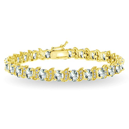 - GemStar USA Yellow Gold Flashed Sterling Silver Aquamarine 6x4mm Oval and S Tennis Bracelet with White Topaz Accents