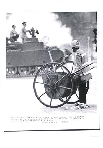 - Vintage photo of A bucurest street sweeper with his handcar.