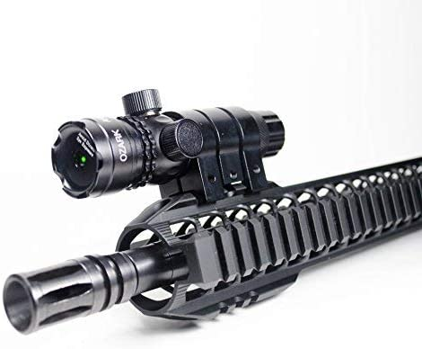 This is an image of an Ozark Armament Green laser light mounted on top of a rifle.