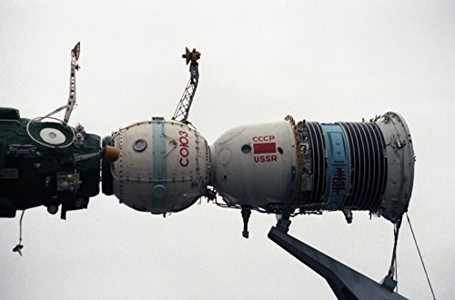 LAMINATED POSTER Model of a Soyuz spacecraft docking with the Salyut-7 space station. The display is in front of one