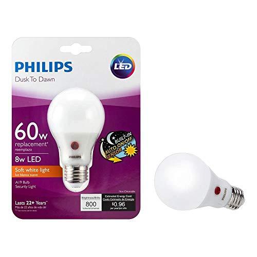 Philips LED 466565 BC8A19/AMB/827/ND D2D 120V 4/1 60 Watt Equivalent Soft White Dusk-Till-Dawn Indoor/Outdoor A19 LED Light Bulb, 4 Pack