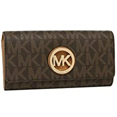 This adorable Fulton Signature Long Continental Clutch Wallet from MK is roomy and spacious. You'll have room for all your essentials and then some while making a real statement. This is a MK must have or a great gift idea! Imported. Style 35...