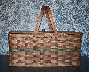 Amish Handmade Large Picnic Basket with Pie Divider Tray and Wood Carrier Handles. Truly the Ultimate in Picnic Baskets! Place Your Homemade Pie in the Bottom of the Basket and Secure It By Placing the Divider on Top of It, Then Place Your Meal and Picnic Supplies Above the Divider. The Double Swinging Handles Balance Out This Handmade Basket When Carried Around. You Won't Find a Better Picnic Basket Around. This Is One of Our Best Sellers! Colors May Vary (Brown, Black, Red, Blue, Green, Purple, Burgundy, Natural) Base 20.25