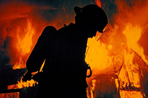 A Firefighter In Airpack Silhouetted By Flames At Night Phot