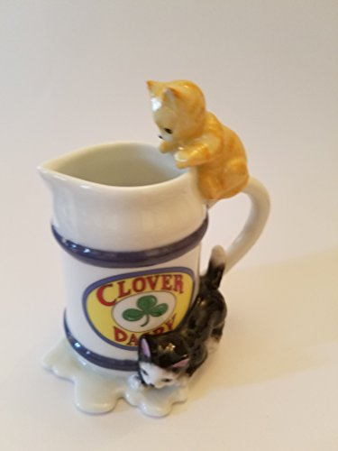Two Adorable little kittens (one Yellow and one Black/white) creamer figurine display (Clover Dairy)