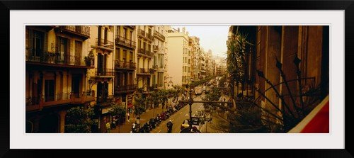 GreatBIGCanvas ''Street Scene Barcelona Spain'' Photographic Print with Black Frame, 48'' x 17'' by greatBIGcanvas