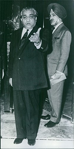 Vintage photo of Maharaja of Baroda standing with another man and talking something, 1968.