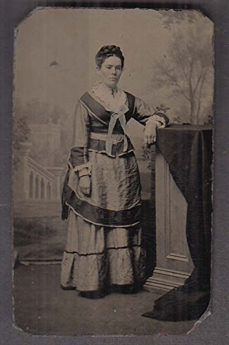 Standing woman multicolored layered dress studio tintype 1860s