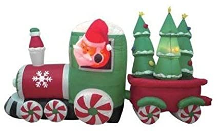 8 foot long inflatable santa claus driving train on candy wheels pulling christmas trees