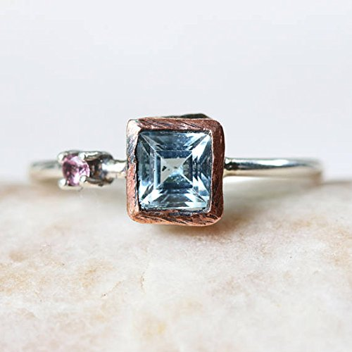 Princess cut Swiss blue topaz ring in copper bezel setting and pink tourmaline on the side with sterling silver high polish finished band