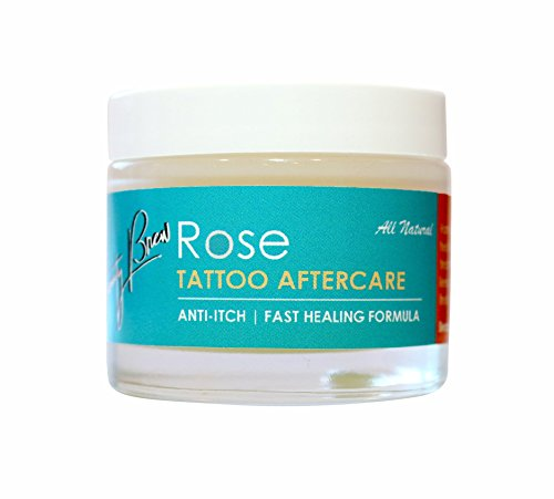 Tattoo Aftercare w/ Rose Oil. NEW! Anti-itch & clinically proven fastest healing formula. 100% Natural made with high potency oils to soothe, heal & protect your tattoos from fading. Net Wt. 2.0 oz - Fading Formula