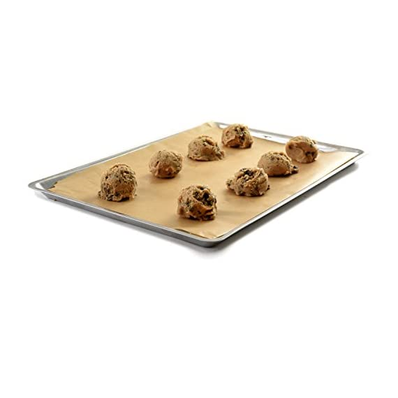 """Norpro Stainless Steel Jelly Roll Baking Pan 3 Measures: 15"""" x 10"""" x .5"""" / 38cm x 25cm x 1.25cm Bake cookies, pastries, biscuits and rolls, pizza, tater tots and fries or use to heat up a sandwich or leftovers. Raised edges all around holds in your sweet or savory creations."""