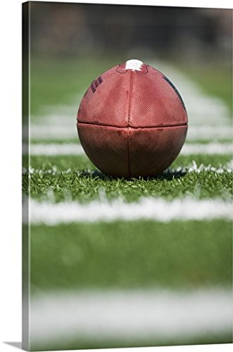 Football Yard Line Markers (Canvas On Demand Premium Outdoor Canvas Wall Art Print entitled Close up of football on yard line)