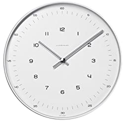 Max Bill clock.30cm diam. Stainless steel case. Quartz movement. Mineral glass face with numbers.