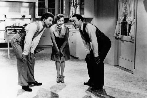 Donald O'Connor and Debbie Reynolds in Singin' in the Rain in kitchen dance scene 24x36 Poster