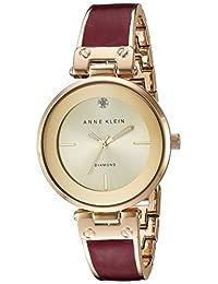 Anne Klein AK/2512BYGB Reloj para mujer, con detalles de diamantes y brazalete color dorado y borgoña marmoleado