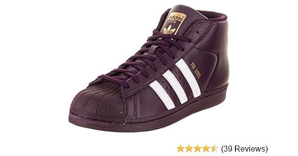 newest 505f8 1d9a6 Amazon.com   adidas Men s Pro Model, White Super Purple Gold Metallic, 8.5  M US   Fashion Sneakers
