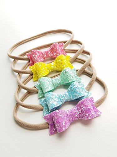 Baby bows and headbands, Sparkly baby bows, Handmade Bows, set of 5 nylon headbands by Vanaguelite