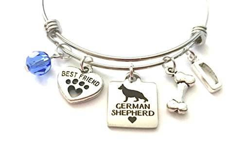 German Shepherd themed personalized bangle bracelet. Antique silver charms and a genuine Swarovski birthstone colored ()