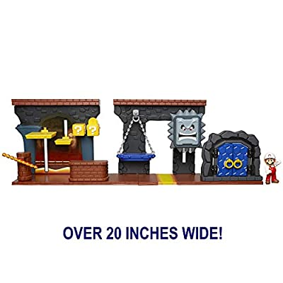 "Nintendo Super Mario Dungeon Deluxe Play Set, Includes: 2.5"" Fire Mario Figure & 7 Interactive Environmentpiece Moving Platforms & Thwomp, Spinning Fire Balls, Hidden Coin, Swing, & Door: Toys & Games"