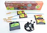 Family Fun Pak Marshmallow Roaster Sticks cooking, roasting hotdogs at backyard patio campfire. Extending Family Fun camping outdoors by fire pit cooking with skewers & forks making Smores on a pole.
