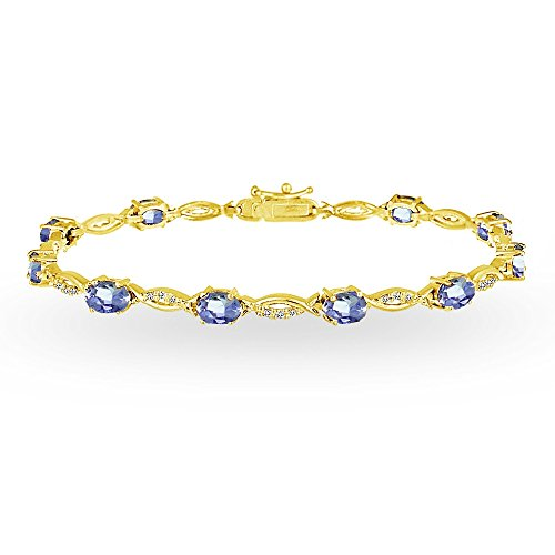 (GemStar USA Yellow Gold Flashed Sterling Silver Tanzanite and White Topaz Oval-Cut Swirl Tennis Bracelet)