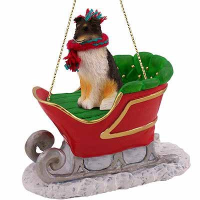 SHETLAND Sheep Dog SHELTIE Tri-color rides on a SLEIGH Tri-Color Christmas Ornament SLD20B