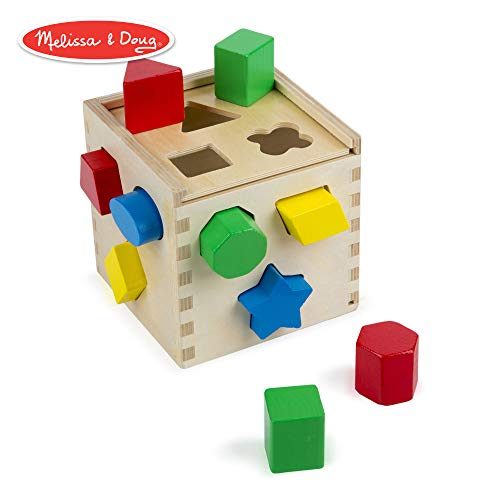 - Melissa & Doug Shape Sorting Cube Classic Wooden Toy, Developmental Toy, Easy-to-Grip Shapes, Sturdy Wooden Construction, 12 Pieces, 5.5″ H × 5.5″ W × 5.5″ L