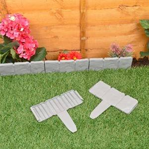 dark grey lakeland stone hammer in garden border edging 384