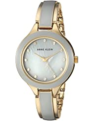 Anne Klein Womens AK/2934GYGB Swarovski Crystal Accented Gold-Tone and Grey Bangle Watch